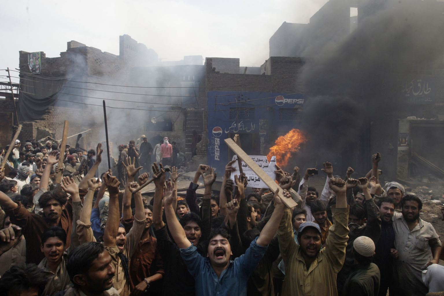 torch muslim Muslim mob torch and loot christian homes and strip pensioner naked in street hundreds of muslims have set fire to dozens of homes and stripped and dragged a 70-year-old woman down the street over.